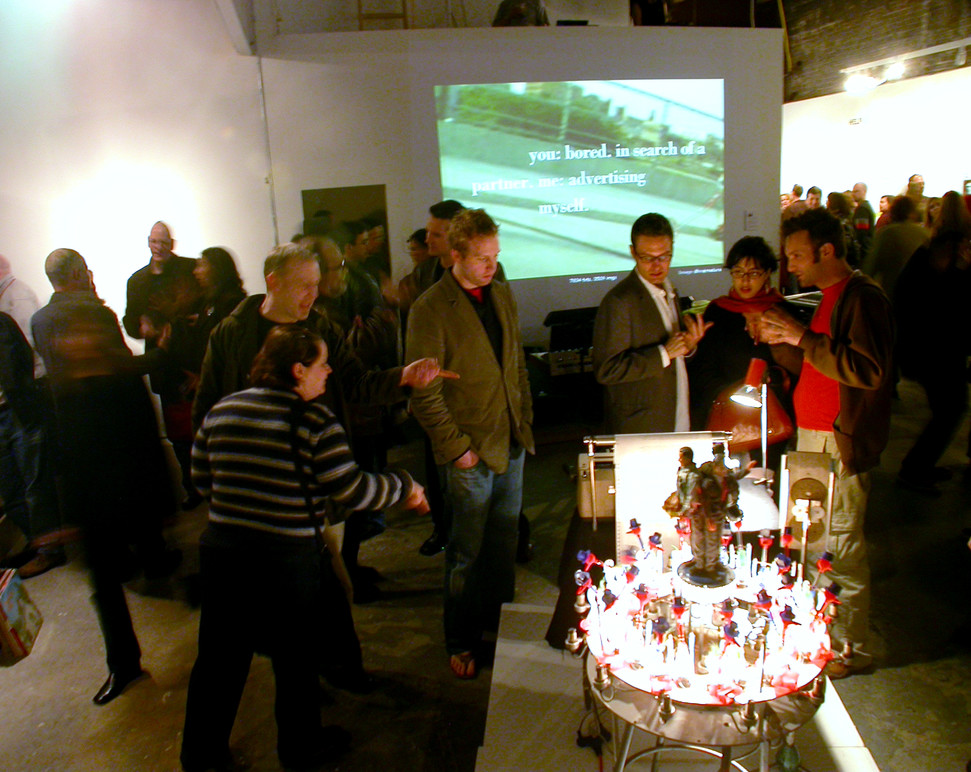 People admiring one of the works.