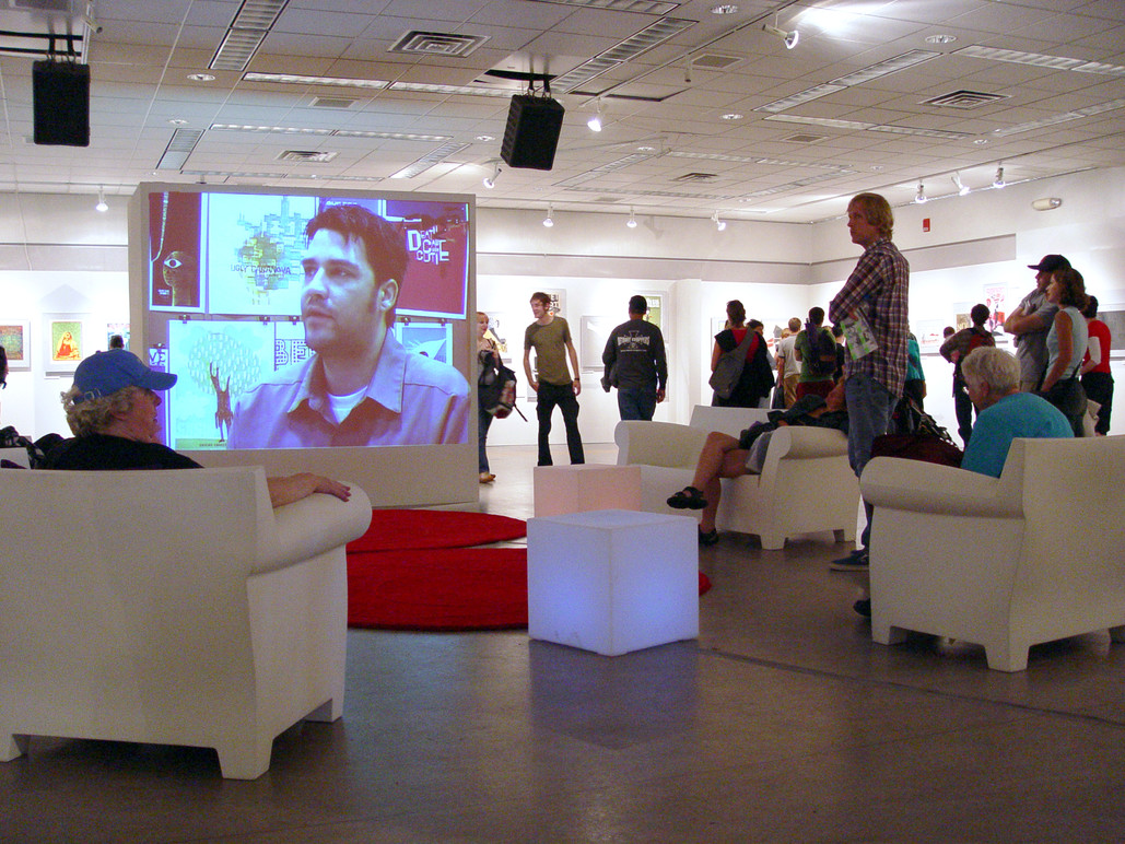 Visitors watching one of the exhibit films.
