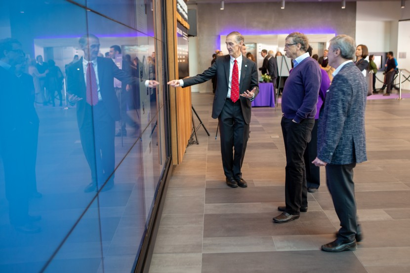 Bill Gates views Tribute Wall content during the new Center's Dedication Event in February 2019.