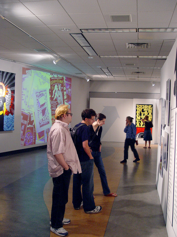 Visitors looking at some of the posters on display.