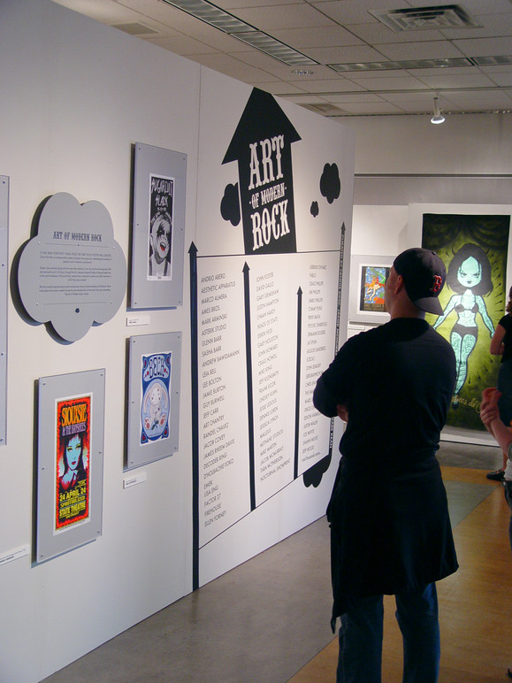 Visitor looking at the exhibition title wall.