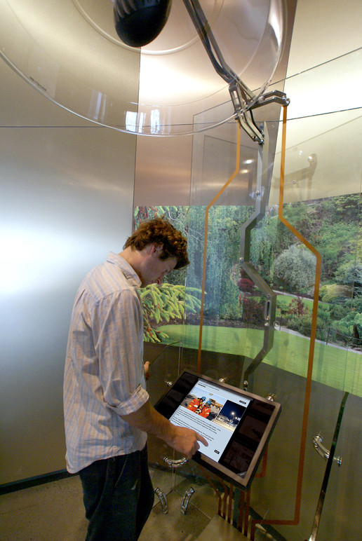 A visitor using the interactive in the gallery.