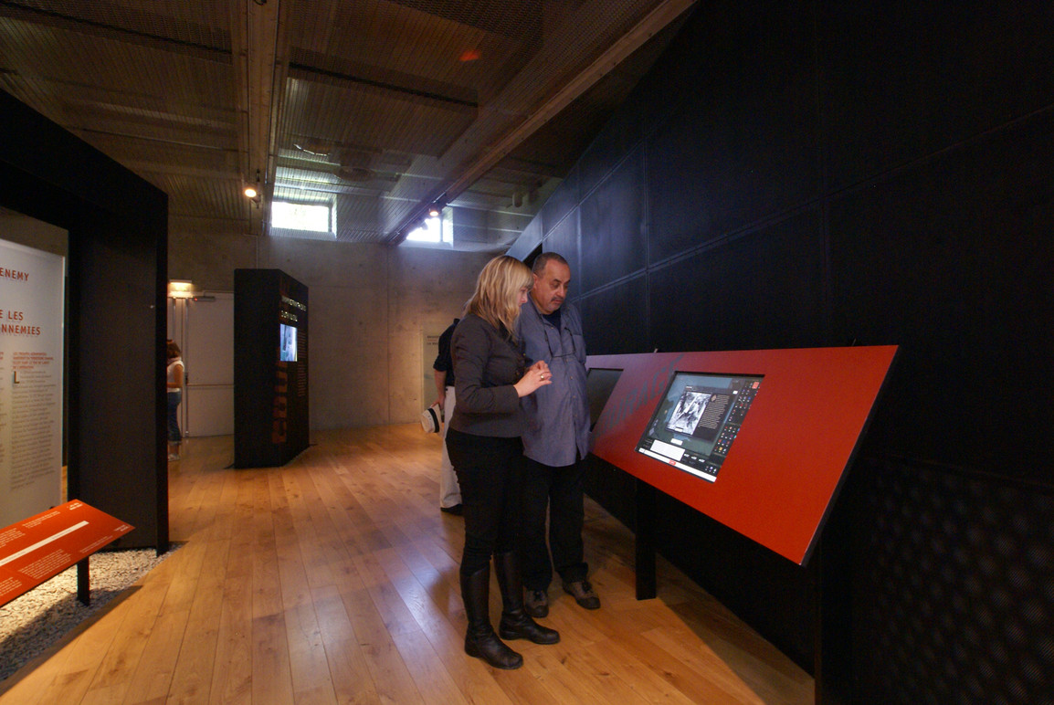 Visitors in the gallery using the kiosk.